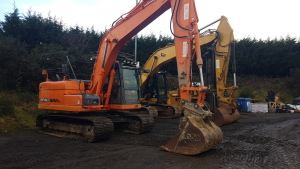 2012 DOOSAN DX140LC steel tracked excavator S/n: JOHC0050669 with bucket, piped & Q/hitch