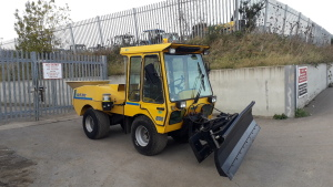 Wolf articulated utility vehicle complete with front mounted snow plough rear mounted spreader