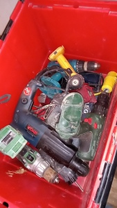 Box of various cordless power tools